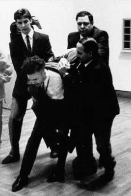 Istvan Kantor, being escorted out of the National Gallery of Canada (photo source: istvankantor.com)